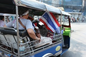 Tuk-tuk with a protester